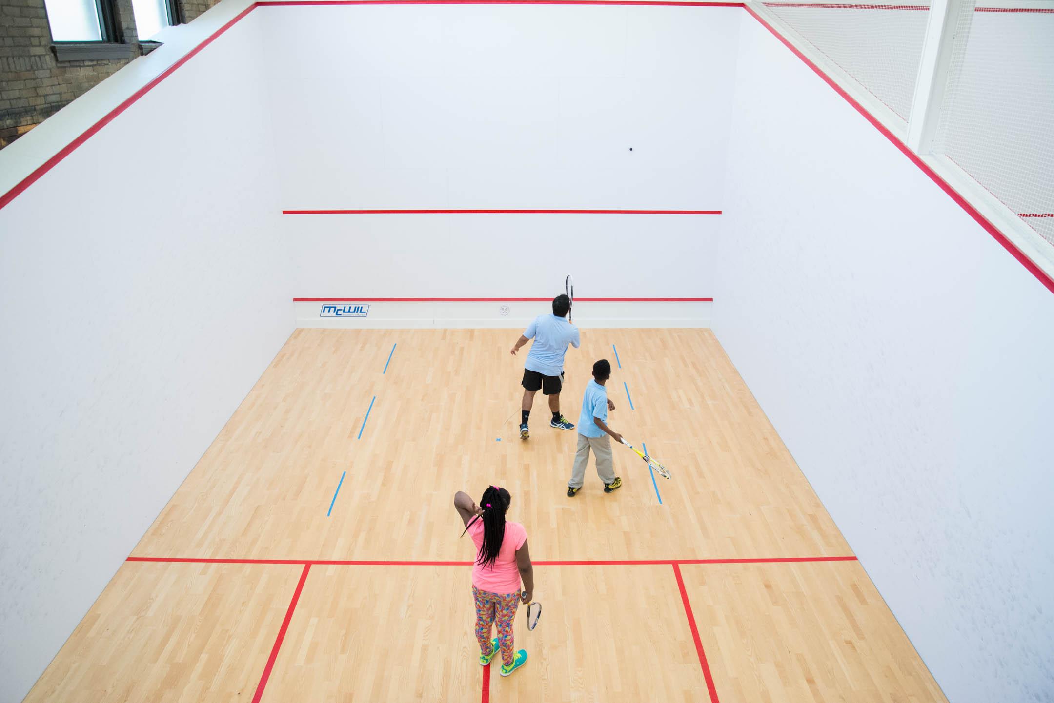 Vir Seth, squash director of the Cincinnati Squash Academy, runs drills with his kids at the Cincinnati Squash Academy Monday May 8, 2017.