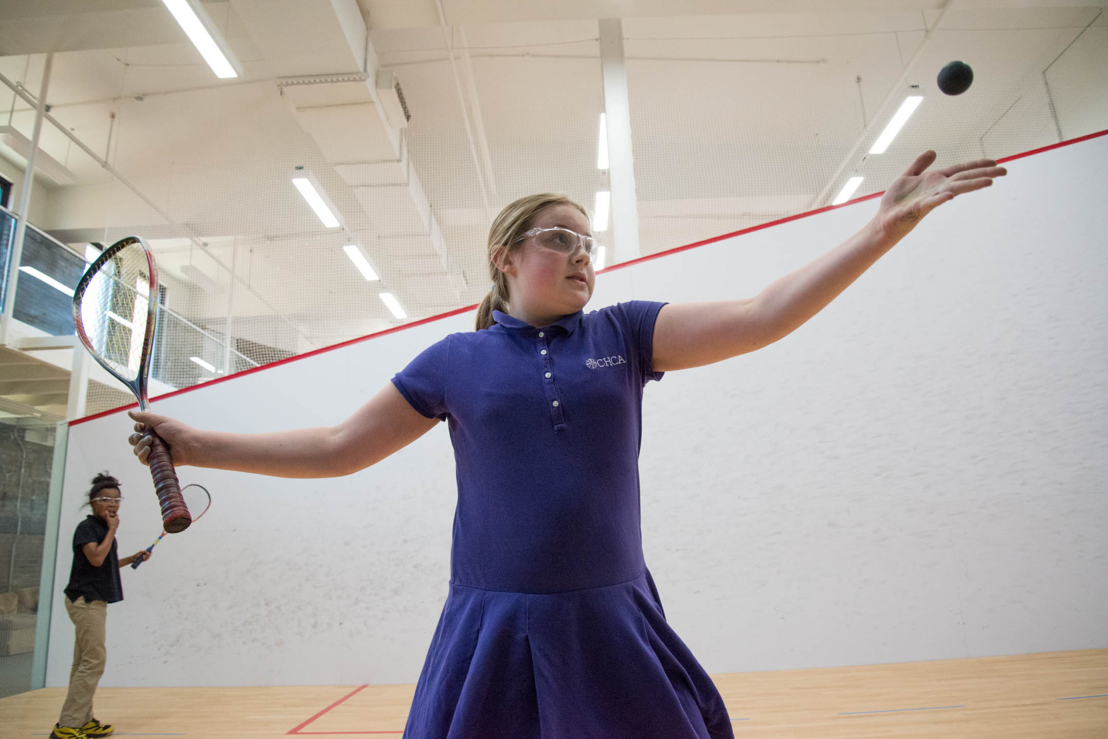 Payton Combs serves the ball in her match with Kiylah Smoot Monday May 8, 2017 at the Cincinnati Squash Academy.