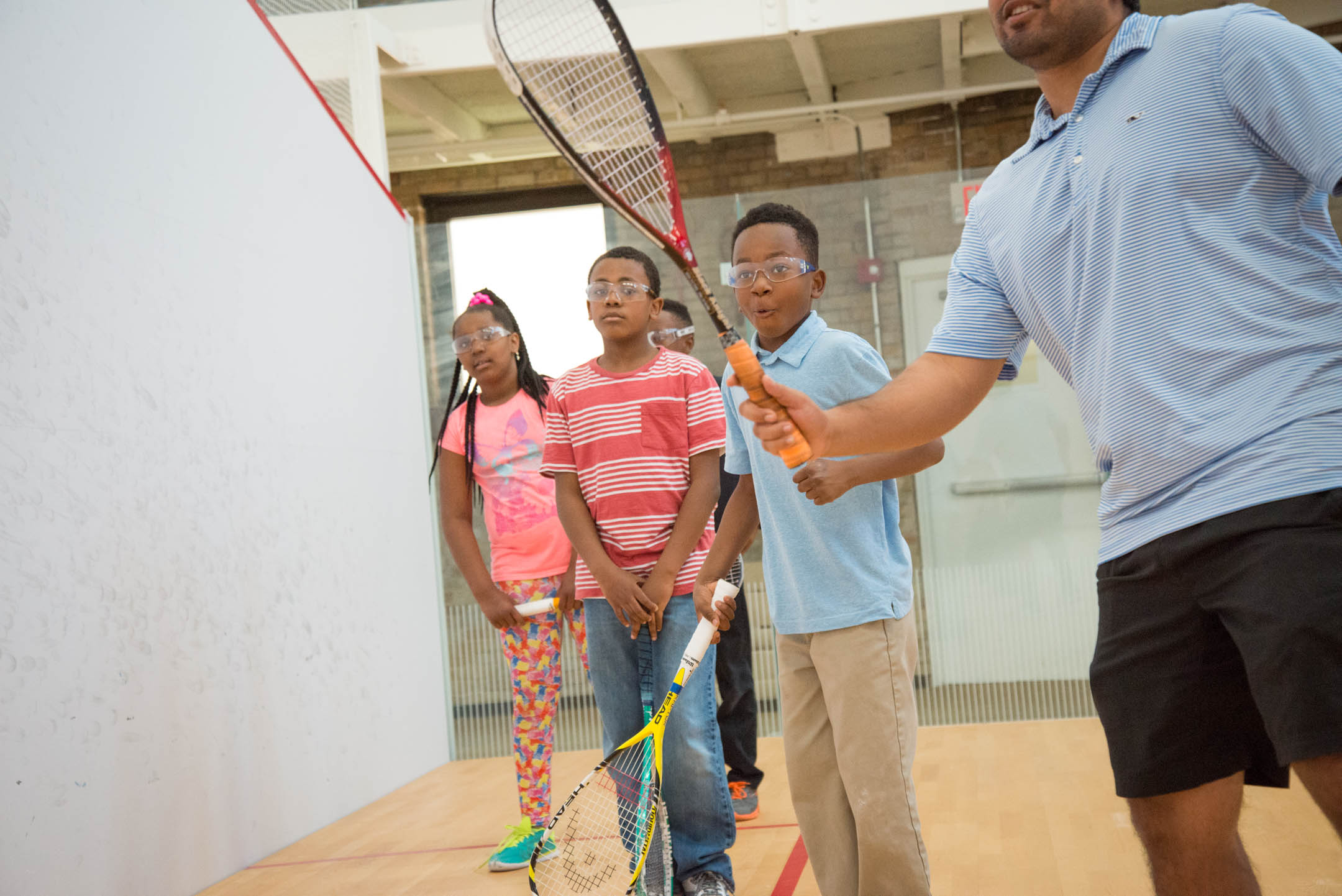 Kids of the Cincinnati Squash Academy watch as Coach Vir Seth show them techniques during practice Monday May 8, 2017.