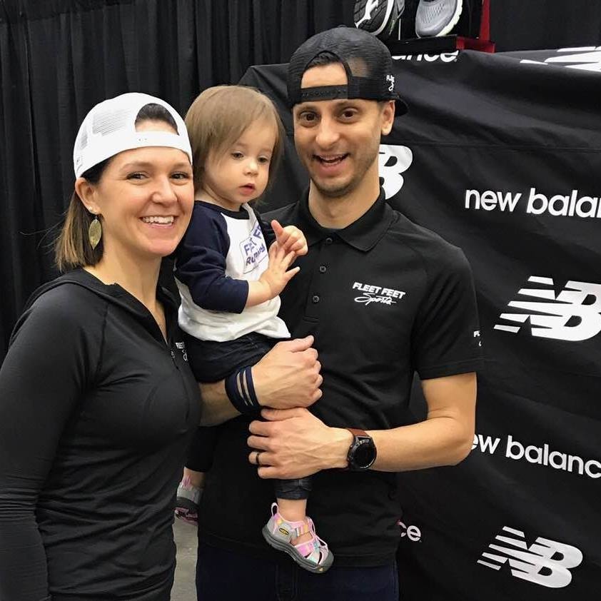 Fleet Feet Cincinnati Co-owners Frank and Stacey DeJulius, along with daughter Olive.