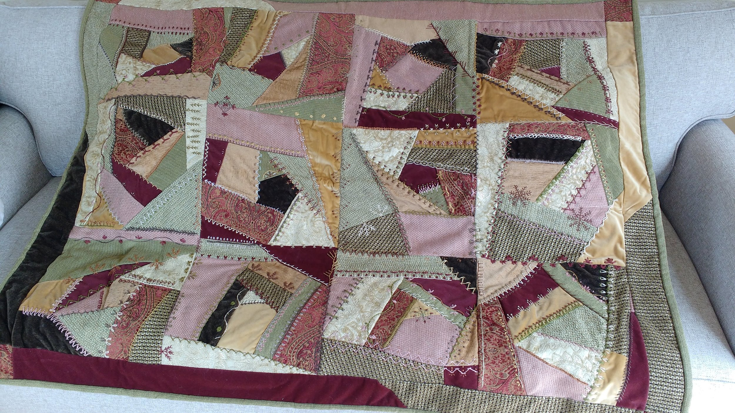 My daughter's quilt, finished almost 10 years ago, and made completely with upholstery fabric she chose. Some look pink here, though they're all browns, reds, golds and greens. Below are 2 more pics with details of my handwork.