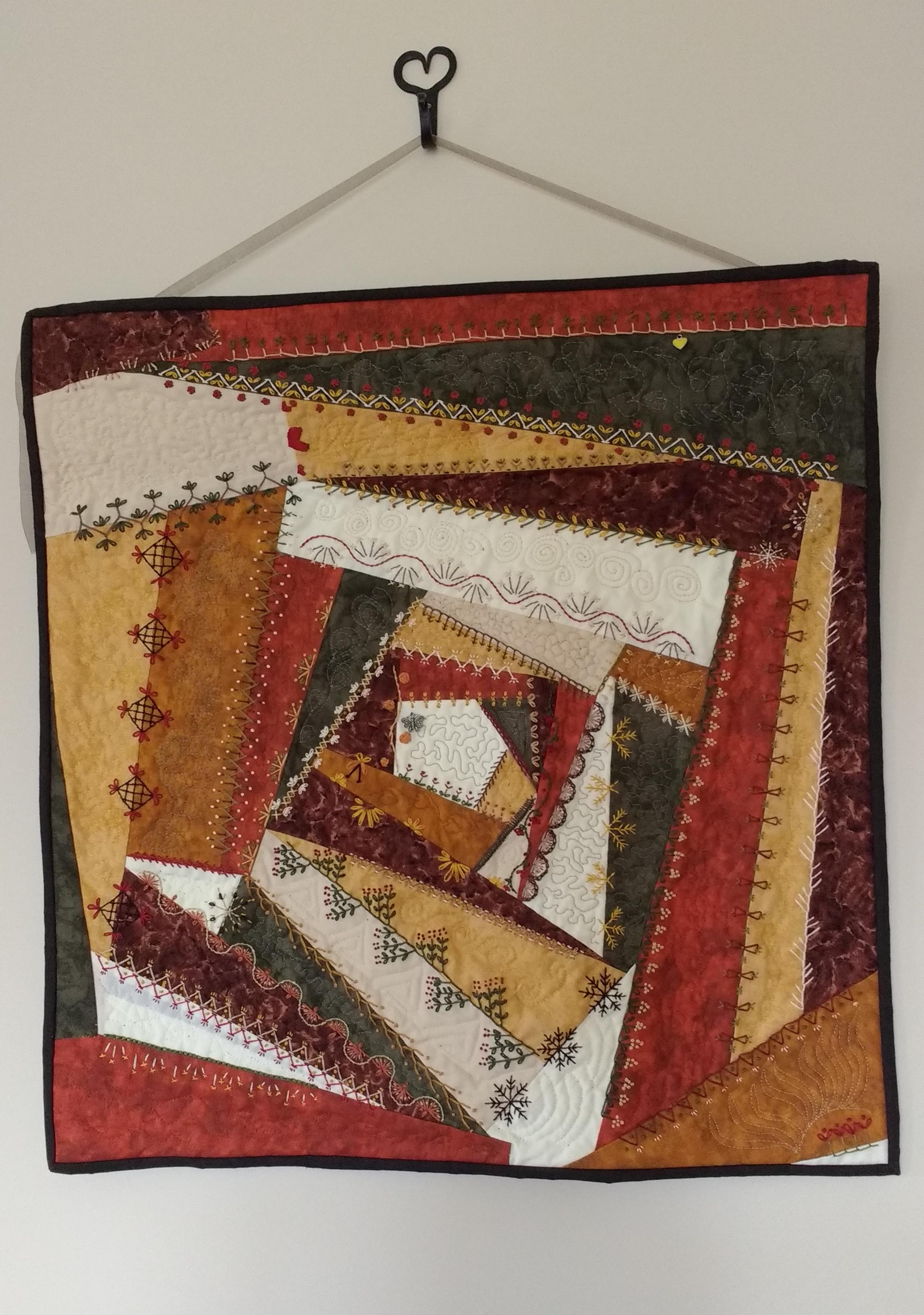 Another original design where I added lots of hand embroidery, as well as machine quilting. I'm loving the fall, earthy colors! And this piece won a 3rd Place Ribbon in the 2018 Vermont Quilt Festival!