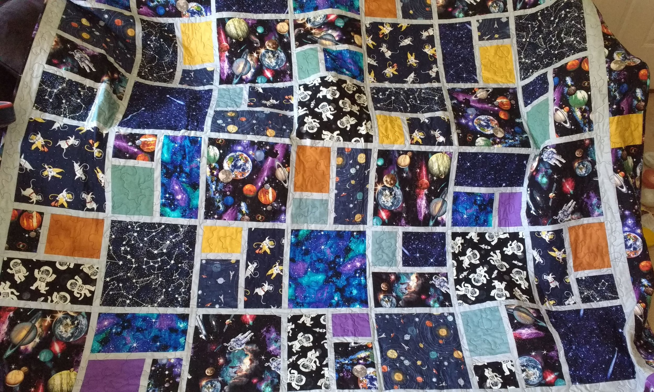 This is a huge bed quilt I designed, made especially for my Space Loving Granddaughter ! I included glow in the dark cats and constellations, and lots of Stars, Saturns and Crescent Moons in the quilting design! See the back below for details....