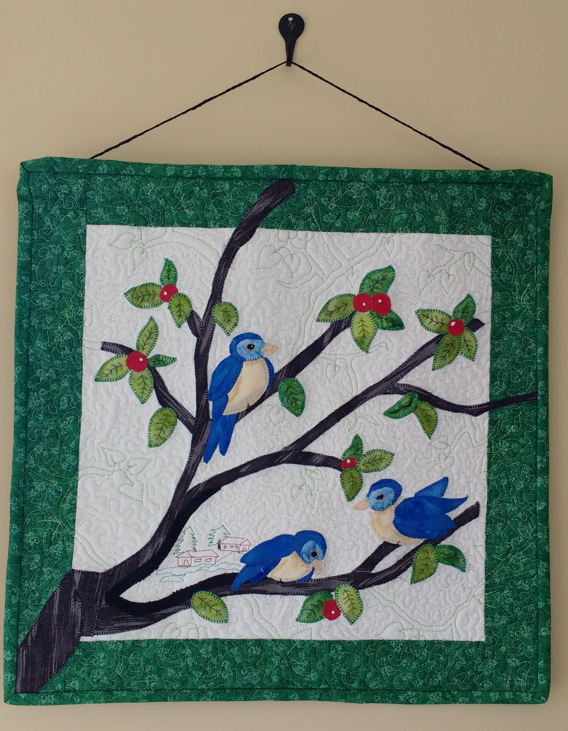 A fun Winter Scene, from Audubon's Block of the Month. Lots of pretty quilting to enhance the background.