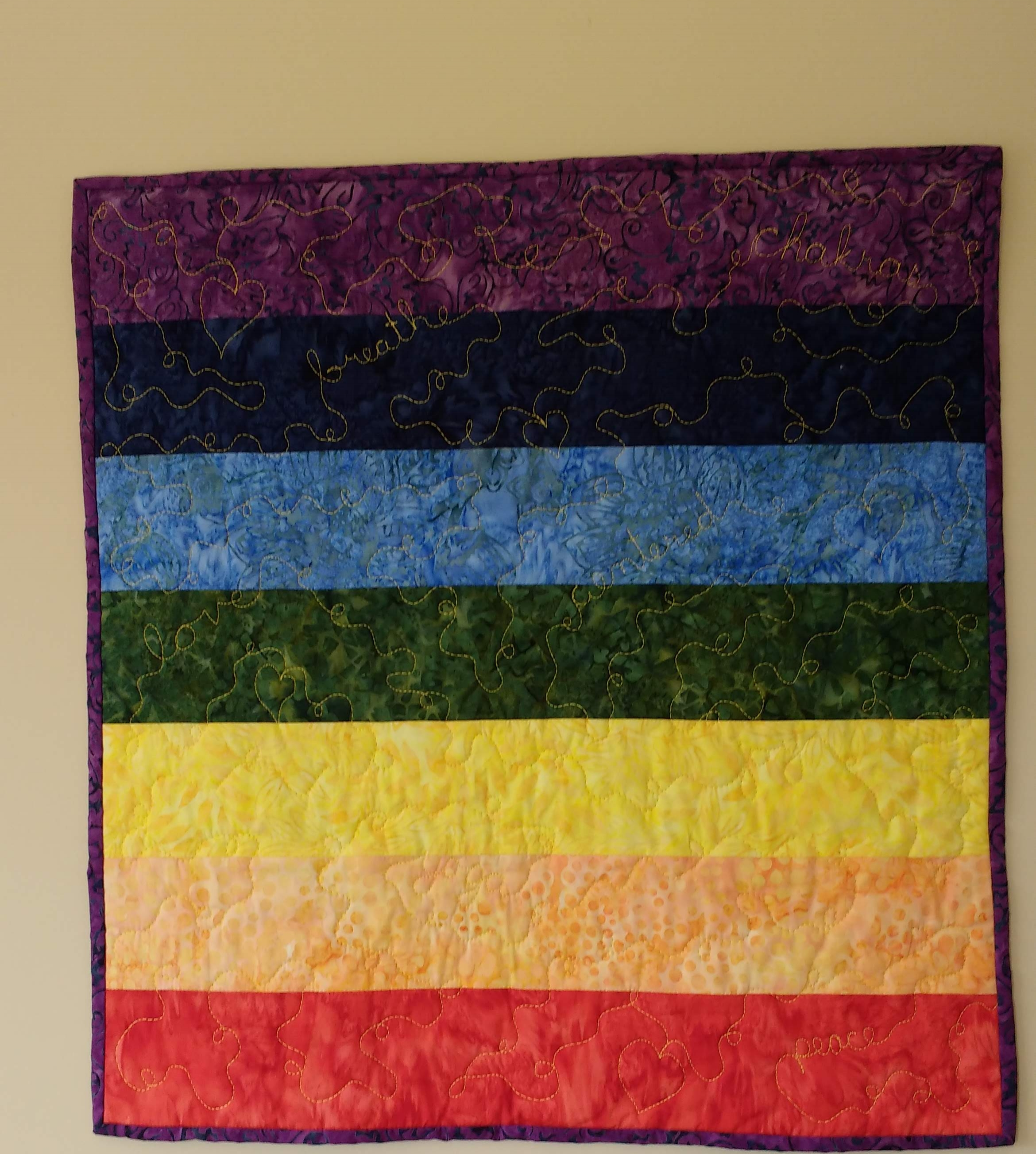 """This is my Original Reiki Wall Art design based on Chakra colors. I've quilted 7 Positive words within this piece: can you find them all?? I can custom design one for you as well, using my own word choice, or yours for someone special! Great for Yoga, Reiki, LBGTQ or just for the beautiful colors, and Happy message! I can quilt up to 8 words within this 20 """" size. You can see this piece on my Etsy shop CustomQuiltsByPaula, or Contact me if you're interested and we can chat -)"""