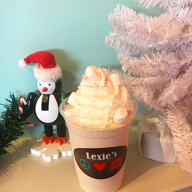 "Our gift shopping? Stop in for a ""Santa's Little Helper"" milkshake ! Made with Vanilla Ice Cream, Crushed Candy Canes, Hot Cocoa mix, topped with Peppermint Whipped Cream, and mini marshmallows ❄️"