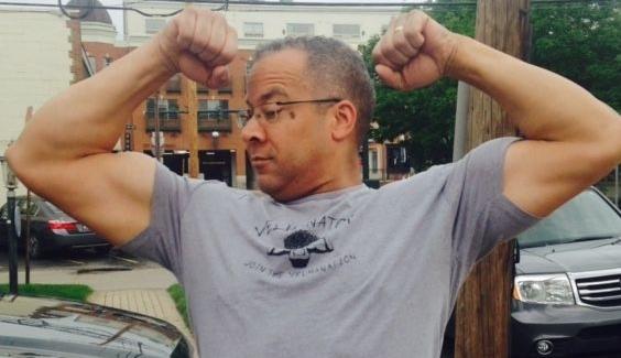 hubby double guns in velmanator shirt.jpg