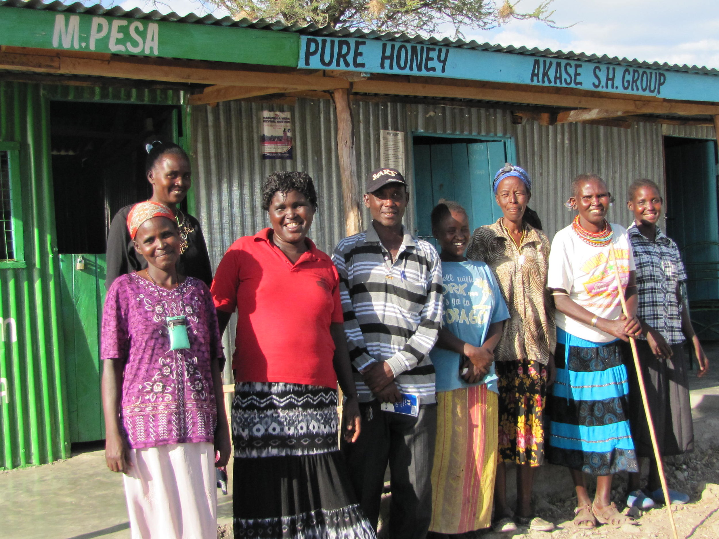 AKASE Self-Help Group in front of their place of business