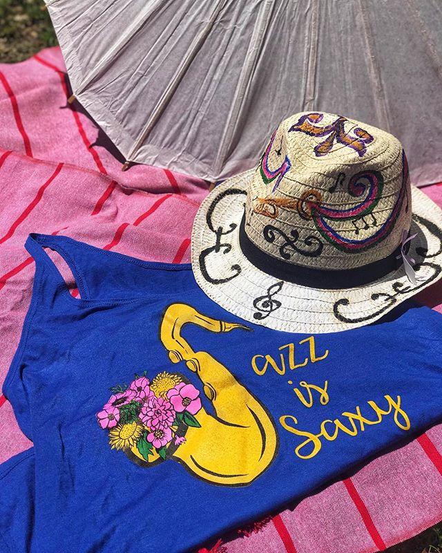 We've got all your festin' essentials at #GlitterBoxNO! 🧢🕶🎷💃 Come visit us in the shop or DM for purchase details! 📷 1: @southernlilt 'Jazz is Saxy' tank top • Rosemary Ciaccio hand painted straw hat • Parasol • Woven blanket 📷2: @thistledohats flat-brim hat • #GlitterBoxGoods fringed sunnies • @fankarafans hand fan 📷3: #GlitterBoxGoods fringed vinyl bag • @alligatorpeargoods sunglasses  #jazzfest #jazzfest2019 #festivalseason #festivalseasonisthebestofallseasons #festivalseasonisthebestseason #supportsmallbusinesses #supportlocalartists #supportwomxnmakers #nolafestivals #nola