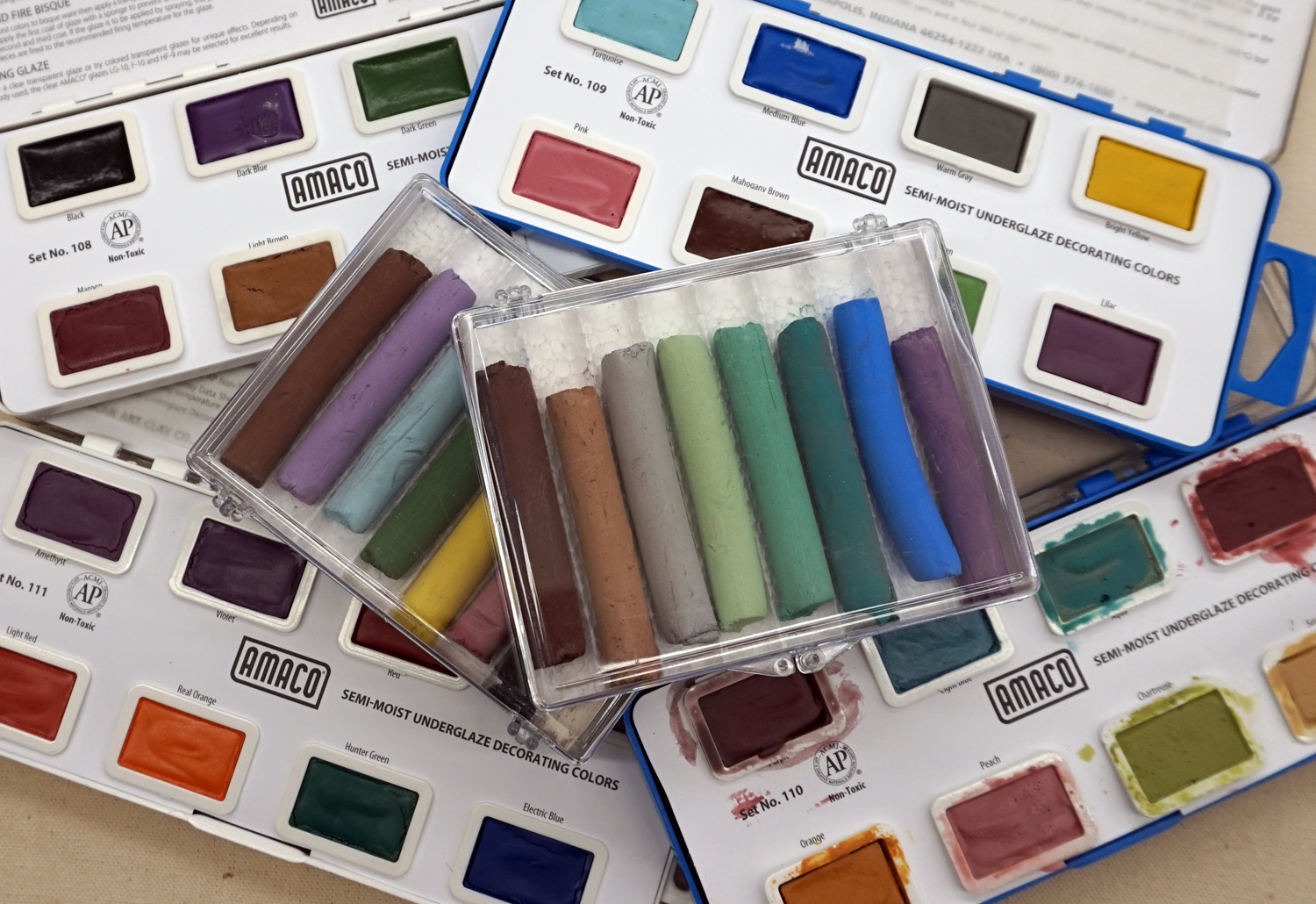 Amaco's  Semi-Moist Underglazes  and Decorating Chalk Crayons are part of the Studio's inventory, as are Mayco's  Designer Liners .