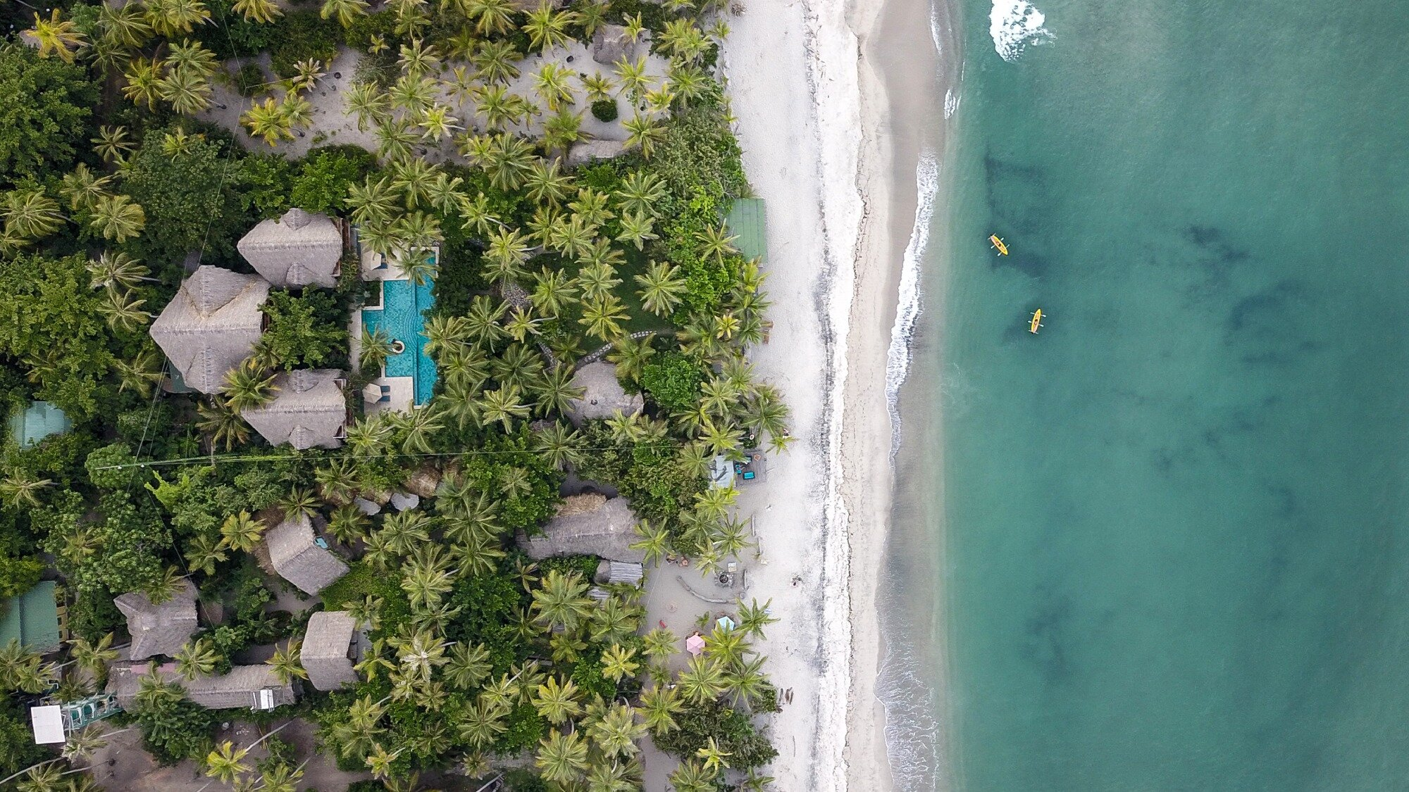 Drone view of Cayena Beach Villa Beach Resort near Tayrona Park.jpg
