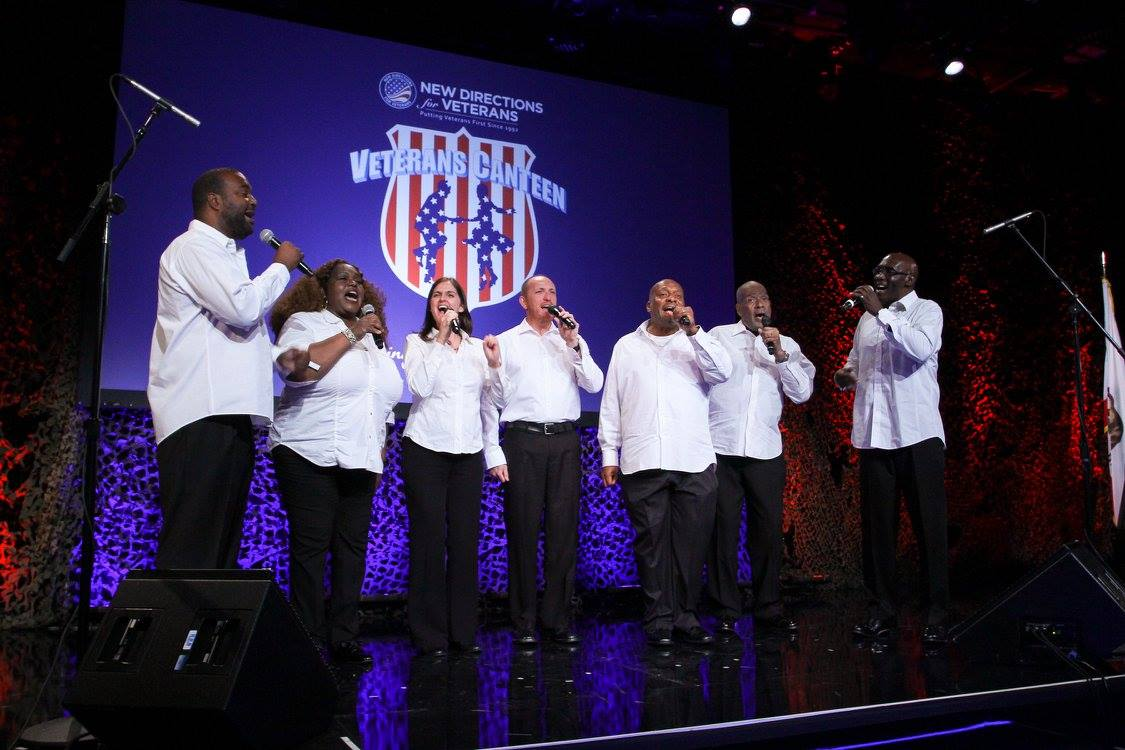 The New Directions Veterans Choir, an award winning a cappella group, performing at the gala