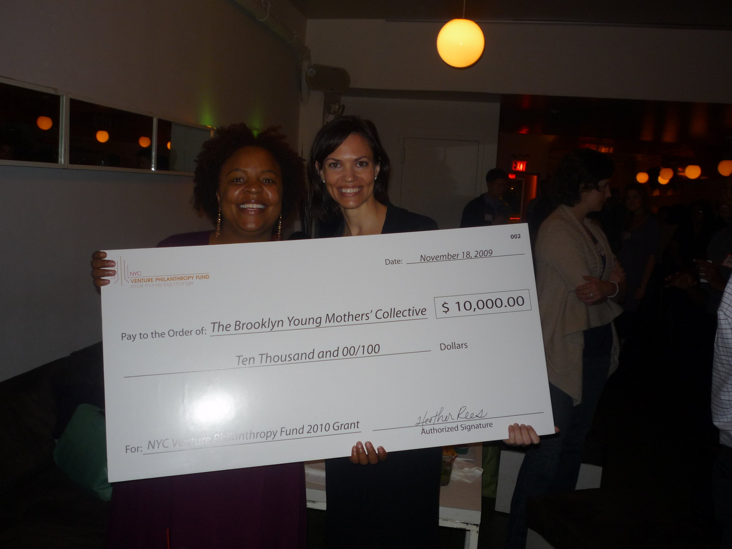 Celebrating with one of the fund's grantees
