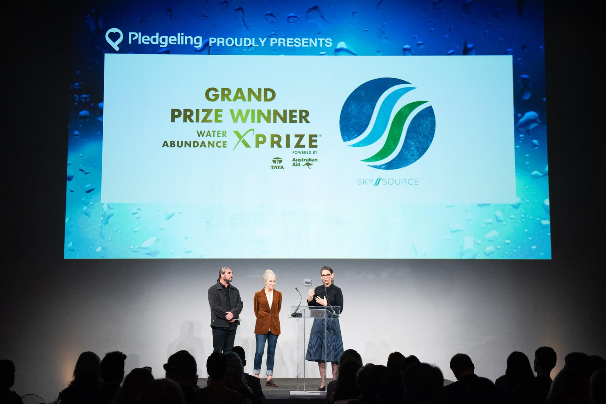 Newly awarded XPrize winners on stage discussing the project that won them the Grand Prize for water sustainability.