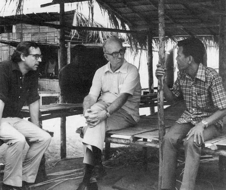Bob DeVecchi Thailand ~1978  James A. Michener (center), a Citizens Commission member, and Robert P. DeVecchi (left), with a refugee official in a Thailand camp.  Picture courtesy of International Rescue Committee.