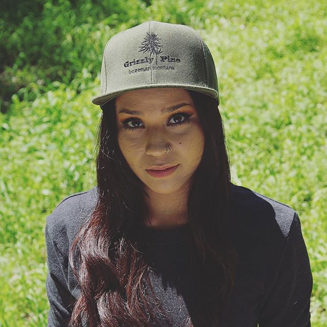 Who's ready for summer already? #tbt of @mandibear_ in one of our og snap backs. #dispensary #cannabisapparel