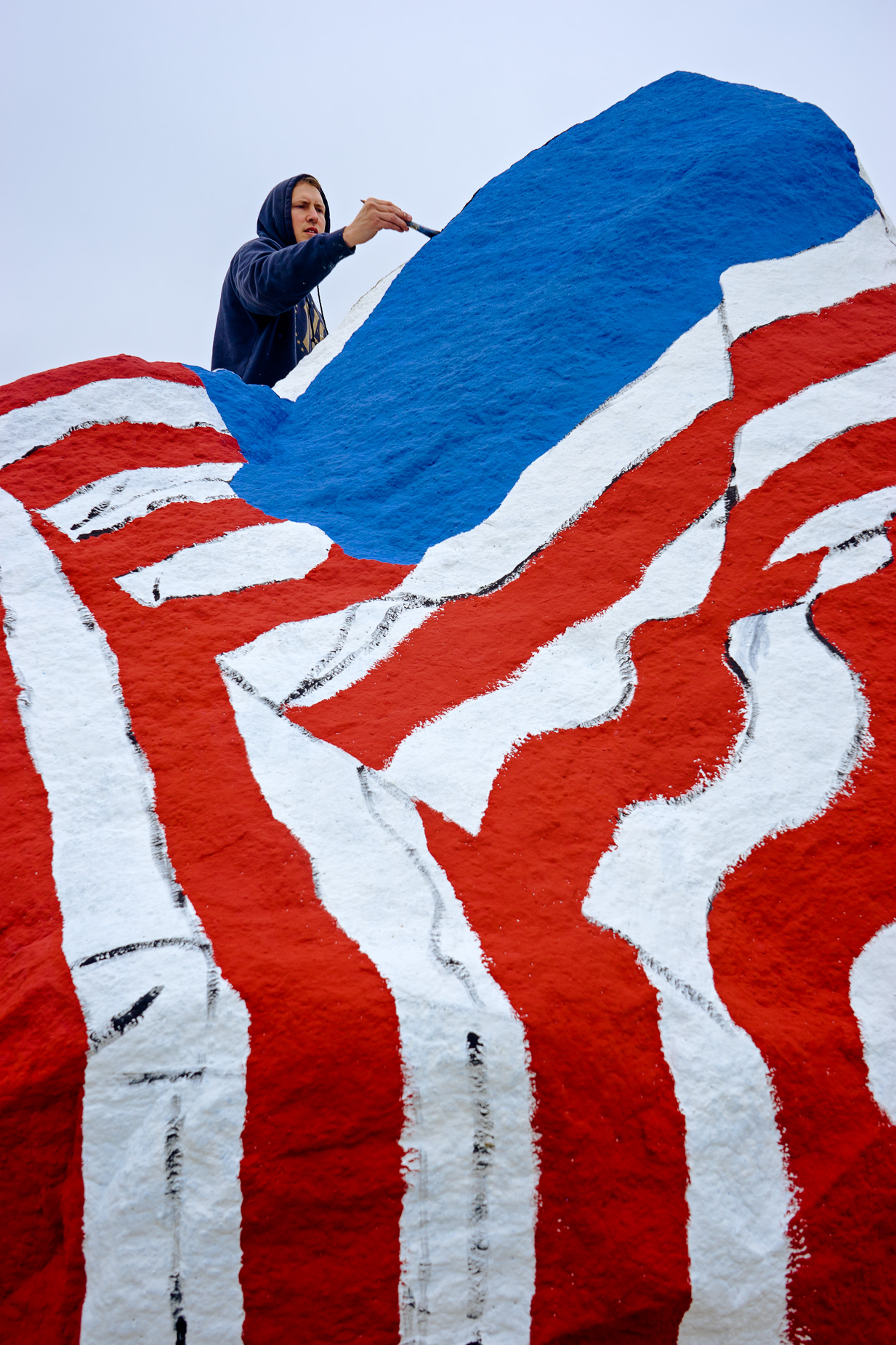 Sorenson paints the American flag during the 2015 version of the Freedom Rock