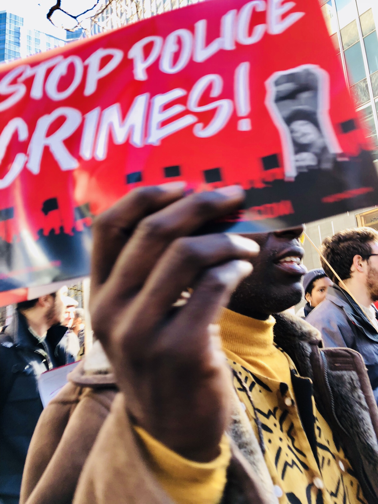 A man holds a sign protesting police crimes in Chicago, Illinois.