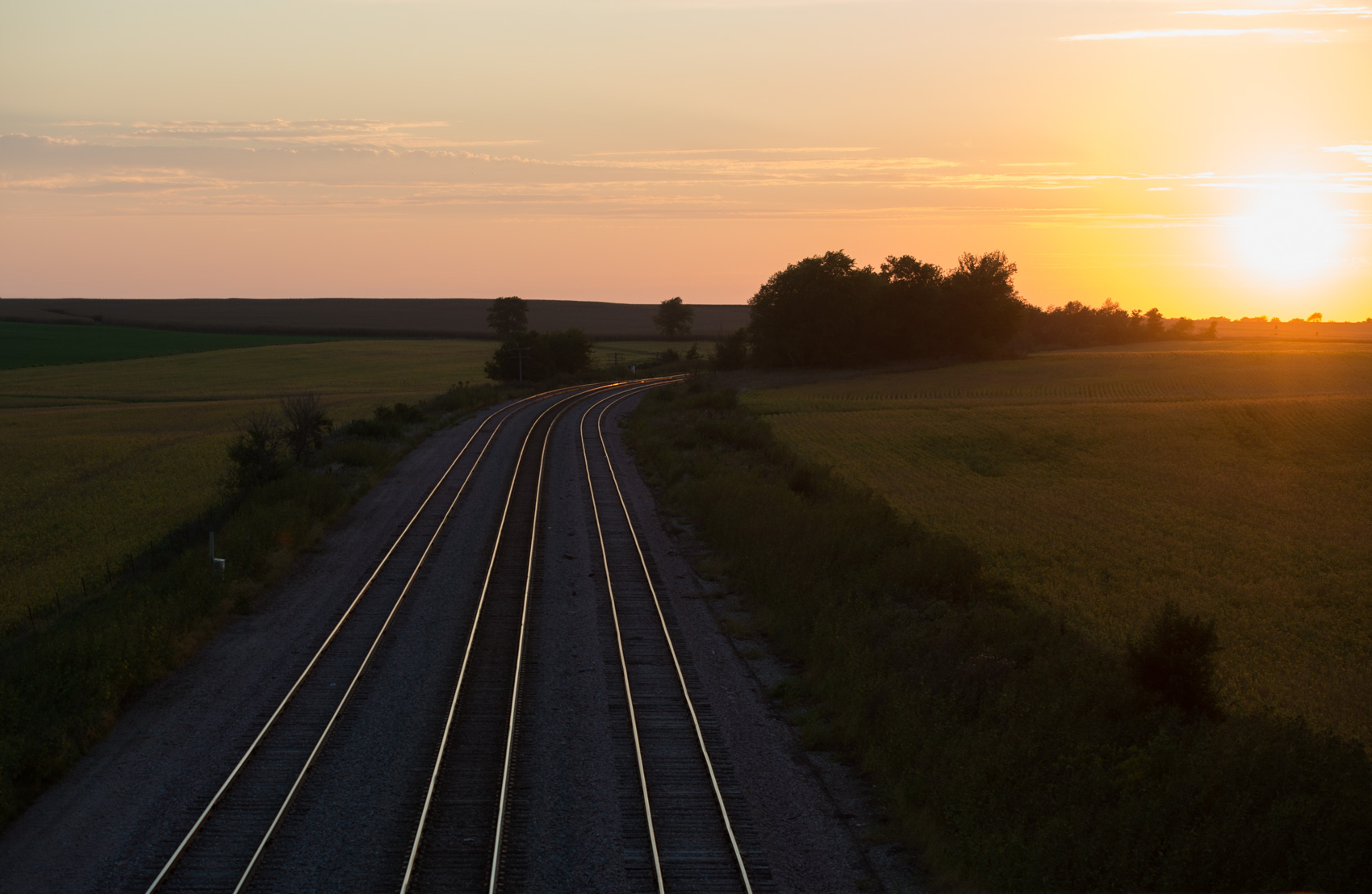 The sun dips towards the horizon creating reflections off of rails near Independence, Iowa. (Photo: Joseph L. Murphy)