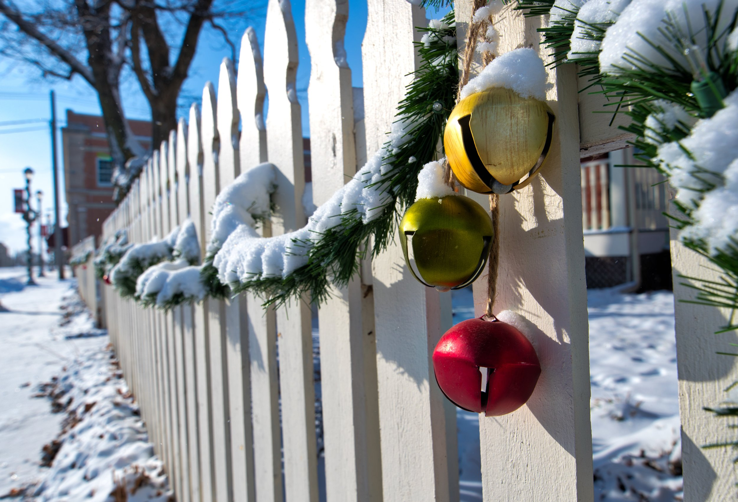 A fresh blanket of snow covers the sidewalks and garland lining a wooden fence near the Winterset town square the day before Christmas. Many Iowan's had a white Christmas after a light storm moved across the state dropping an inch to two-inches of snow. (Photo: Joseph L. Murphy)