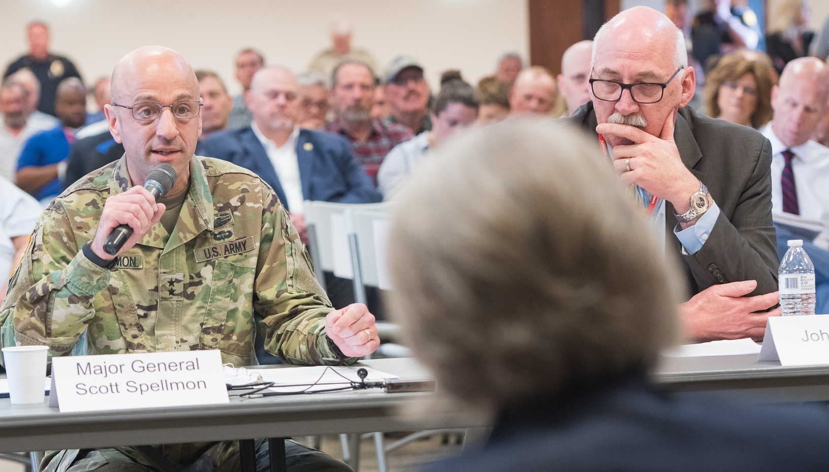 Major General Scott Spellmon (left) responds to a question during a field hearing in Glenwood on Wednesday.
