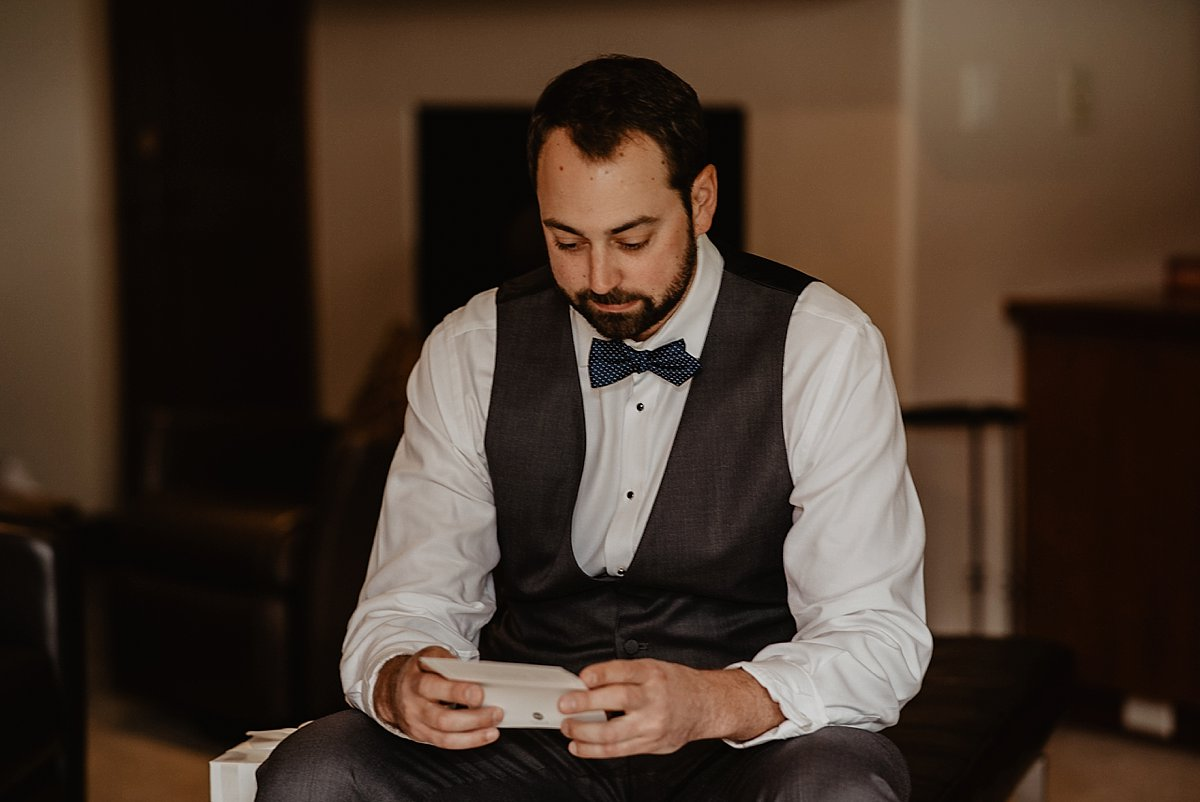 Groom getting ready on his wedding day at the hotel by  Lisa Fitts Photography