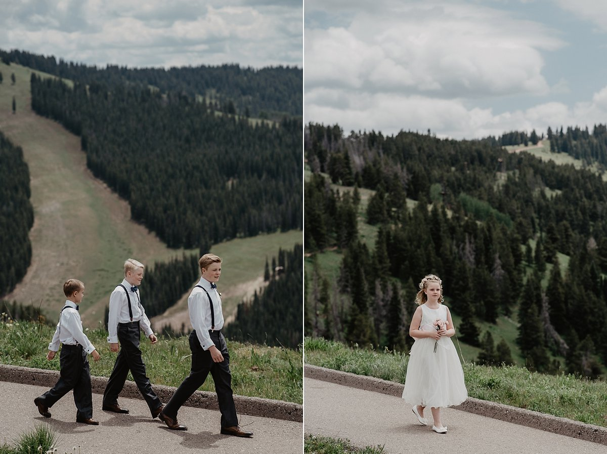 Flowergirl on their way to the altar at The Vail Wedding Deck in Vail, Colorado by Lisa Fitts Photography