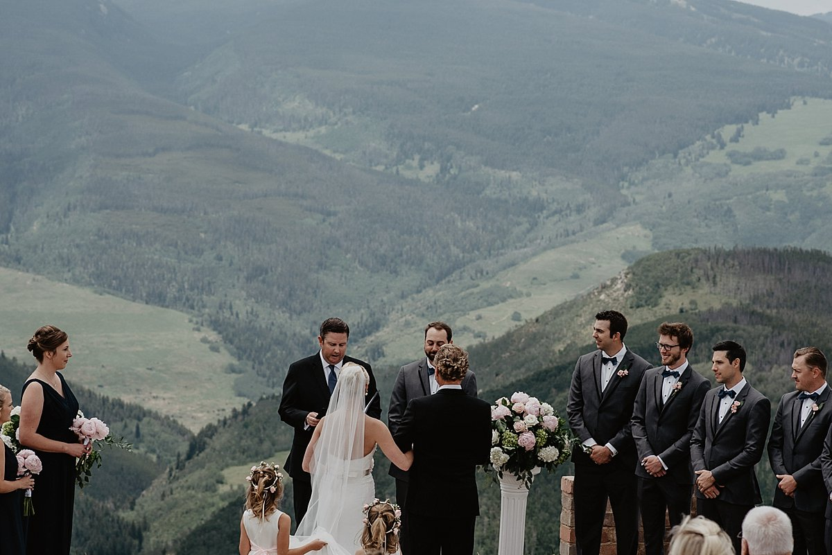 Wedding guests watching bride and groom at The Vail Wedding Deck in Vail, Colorado by Lisa Fitts Photography
