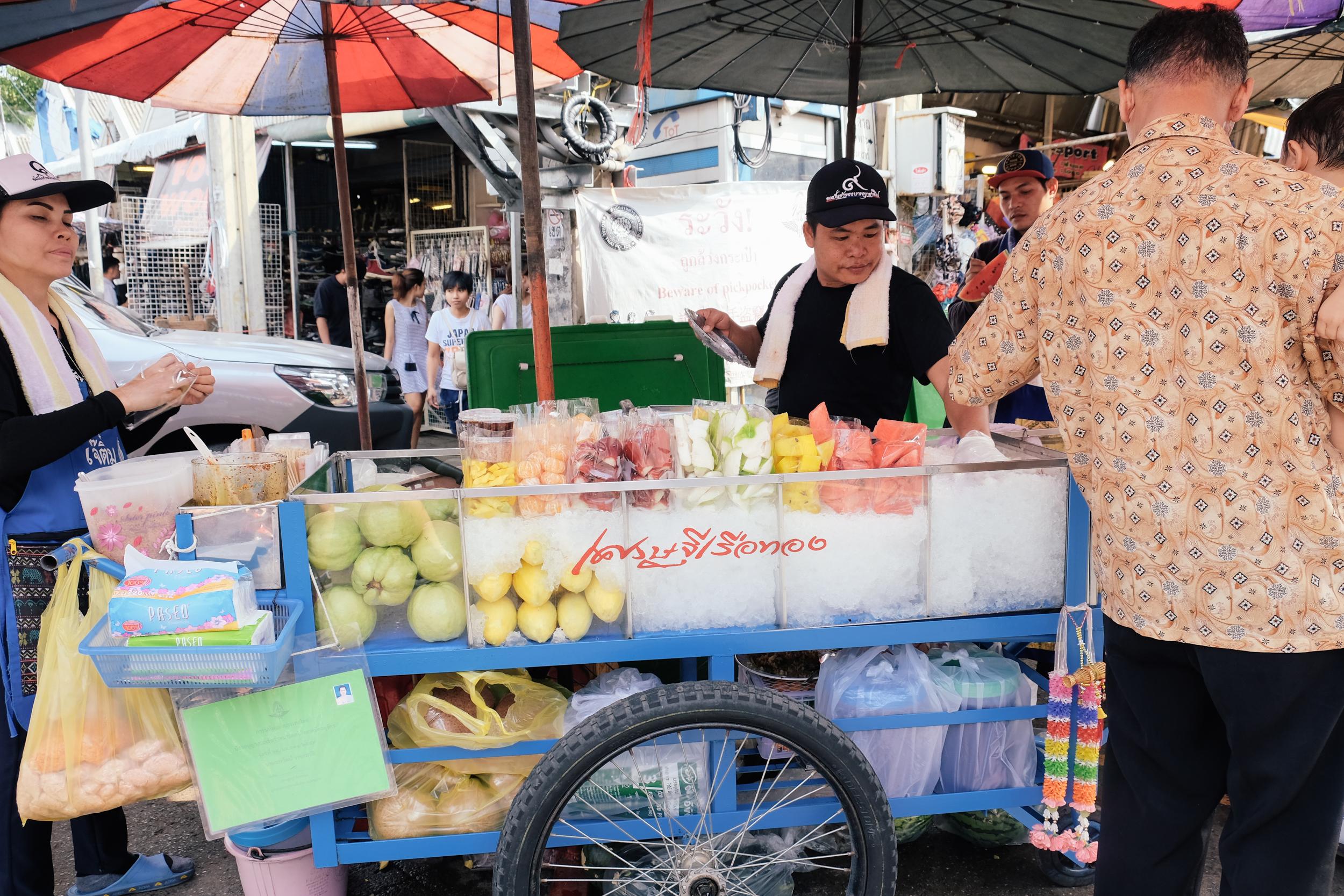 A fruit vendor. Such colorful fruits!