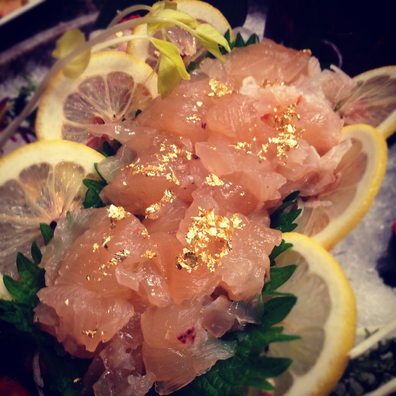 Lobster sashimi with gold flakes