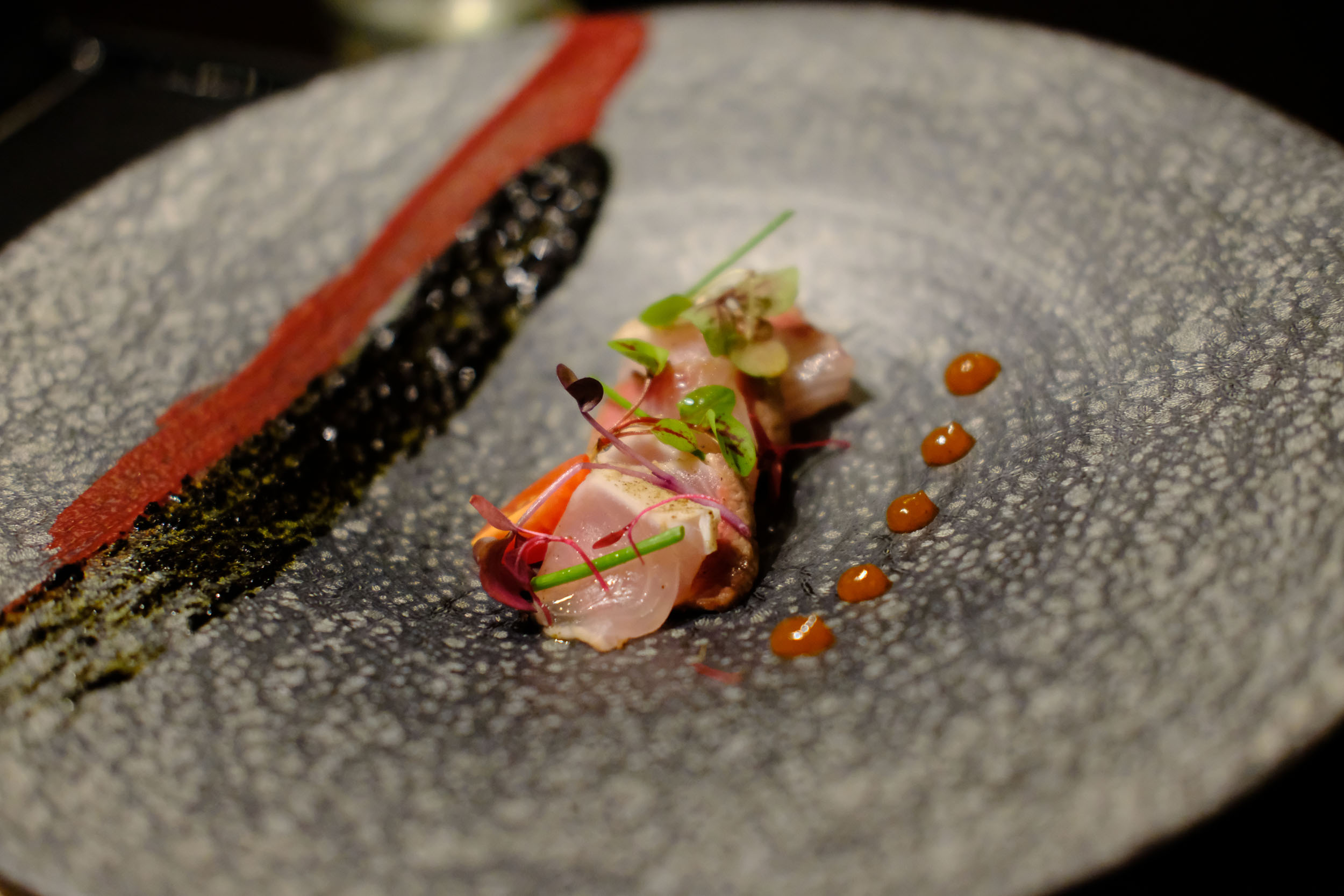 Seared amberjack with beet and nori puree
