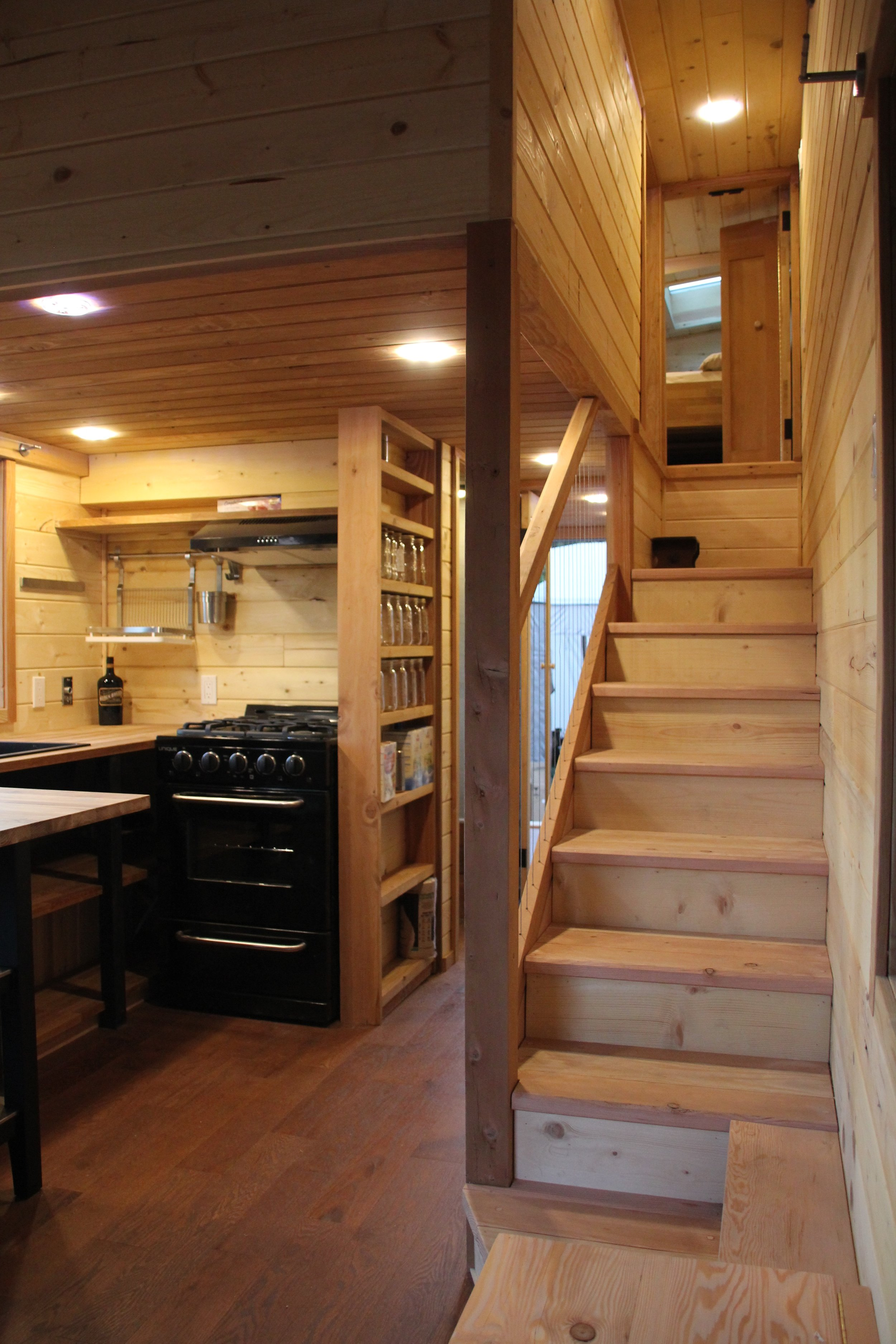 The moveable peninsula and custom shelving add to the functionality of the kitchen.
