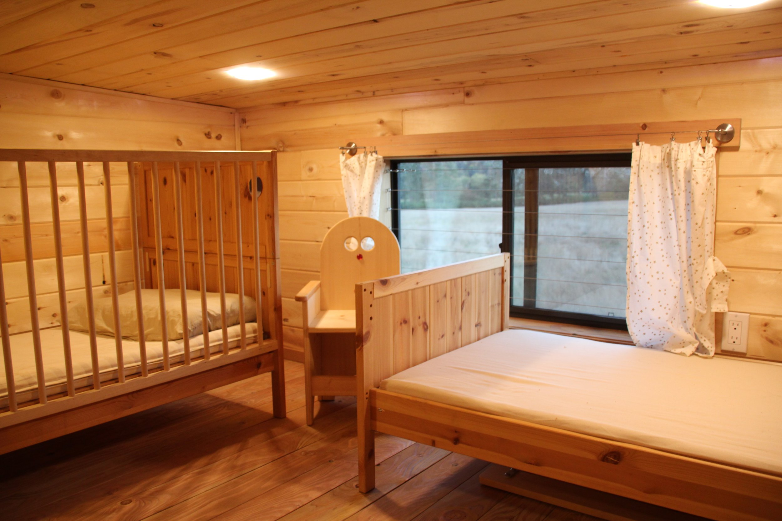 The childrens' room is one of the two bedrooms, both upstairs.