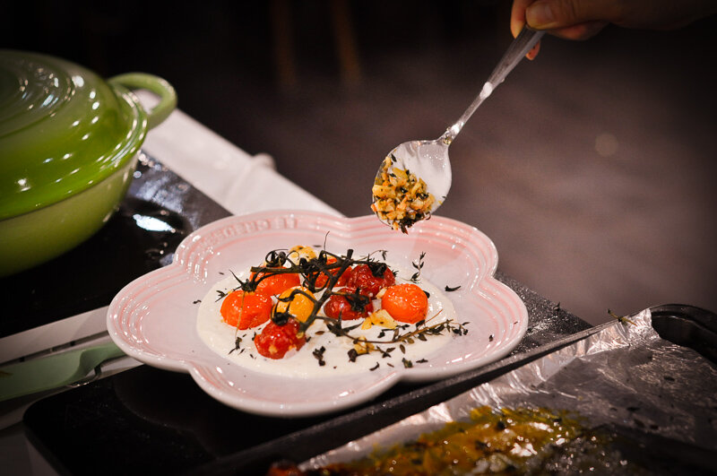 Charred cherry tomato on Greek yoghurt.