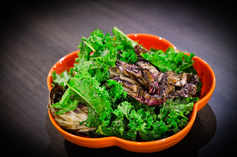 Grilled romaine and kale salad with a red wine balsamic vinaigrette.