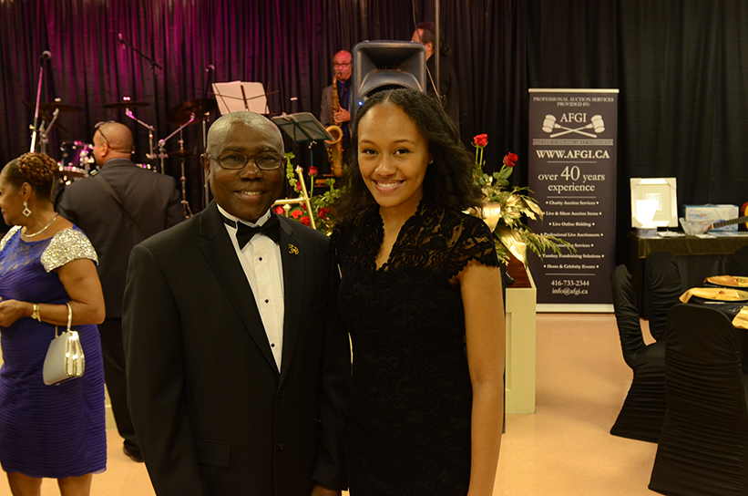 Barbados consul general Haynesley Benn presented a Club Carib scholarship to Garielle Chen