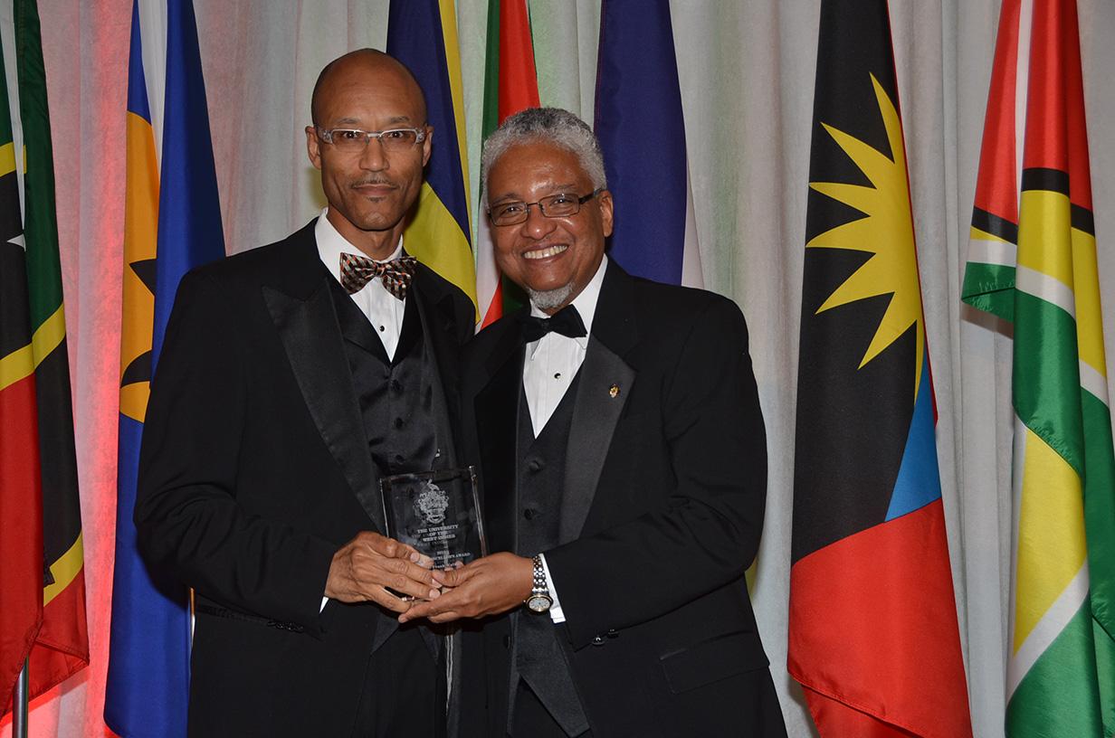 Frank Walwyn receives vice-chancellor award from Dr. Nigel Harris
