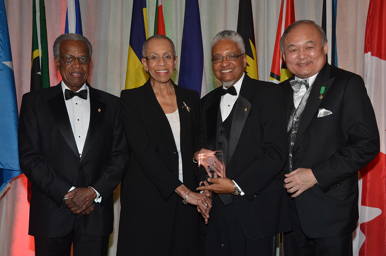 Zanana Akande receives UWI vice-chancellor award from Dr. Nigel Harris in the presence of Ray Chang and Sir George Alleyne