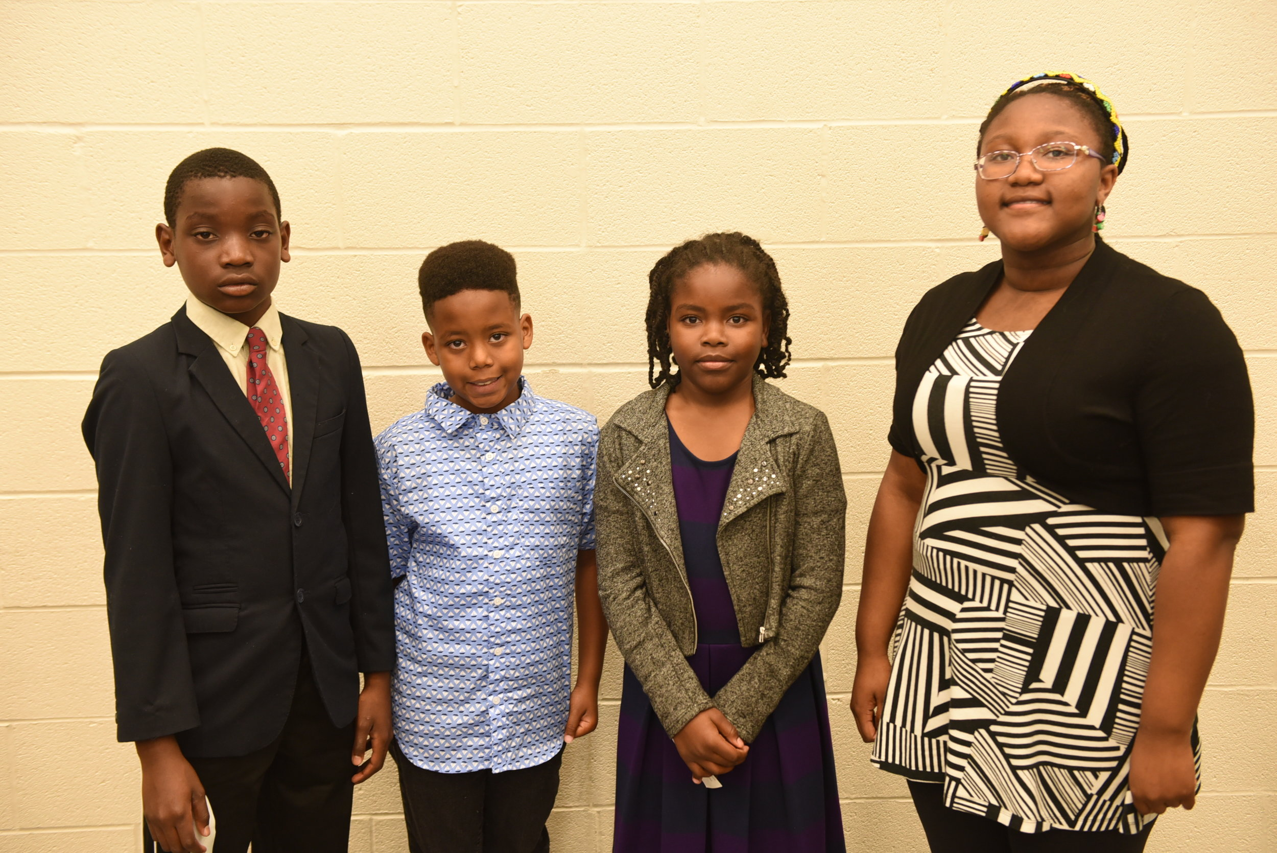 Elementary school awardees Idine Mbong (l), Gabrielle Williams, Josiah Walker & Olalou Oduwole