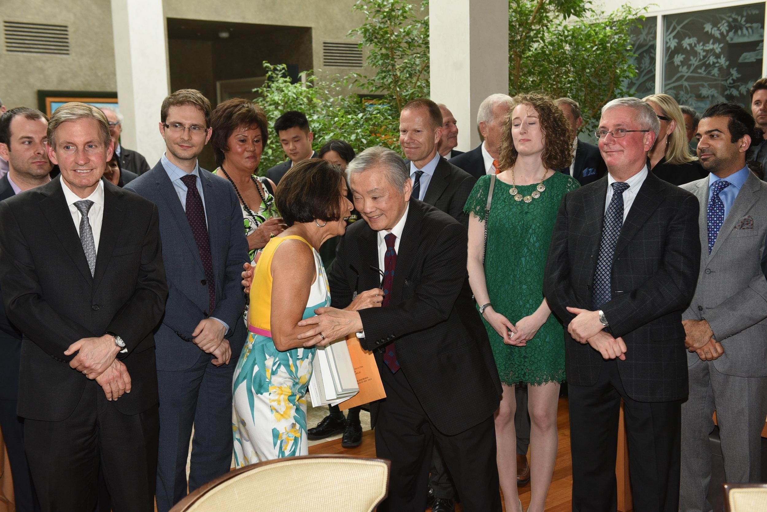 Donette Chin-Loy Chang congratulates Dr. Herbert Ho Ping Kong