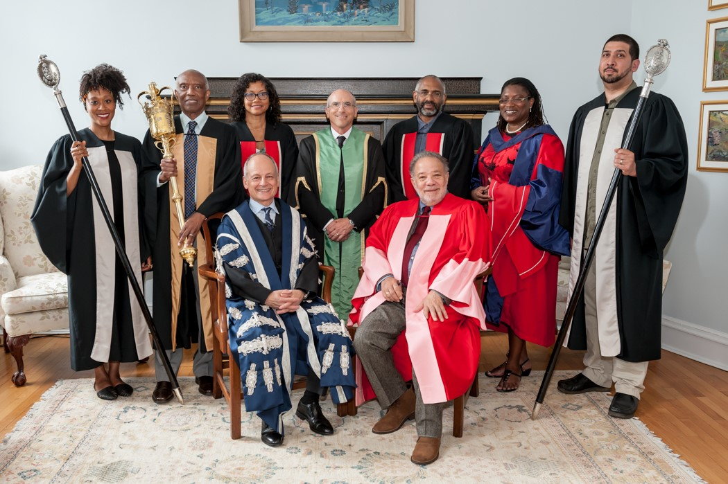 Standing from left are Lahoma Thomas, Dr. Ivan McFarlane, Dr. Alissa Trotz, New College principal Yves Roberge, Professor David Scott, Dr. Melanie Newton & Kevin Edmonds.  Seated are U of T president Meric Gertler and Dr. Robert Hill