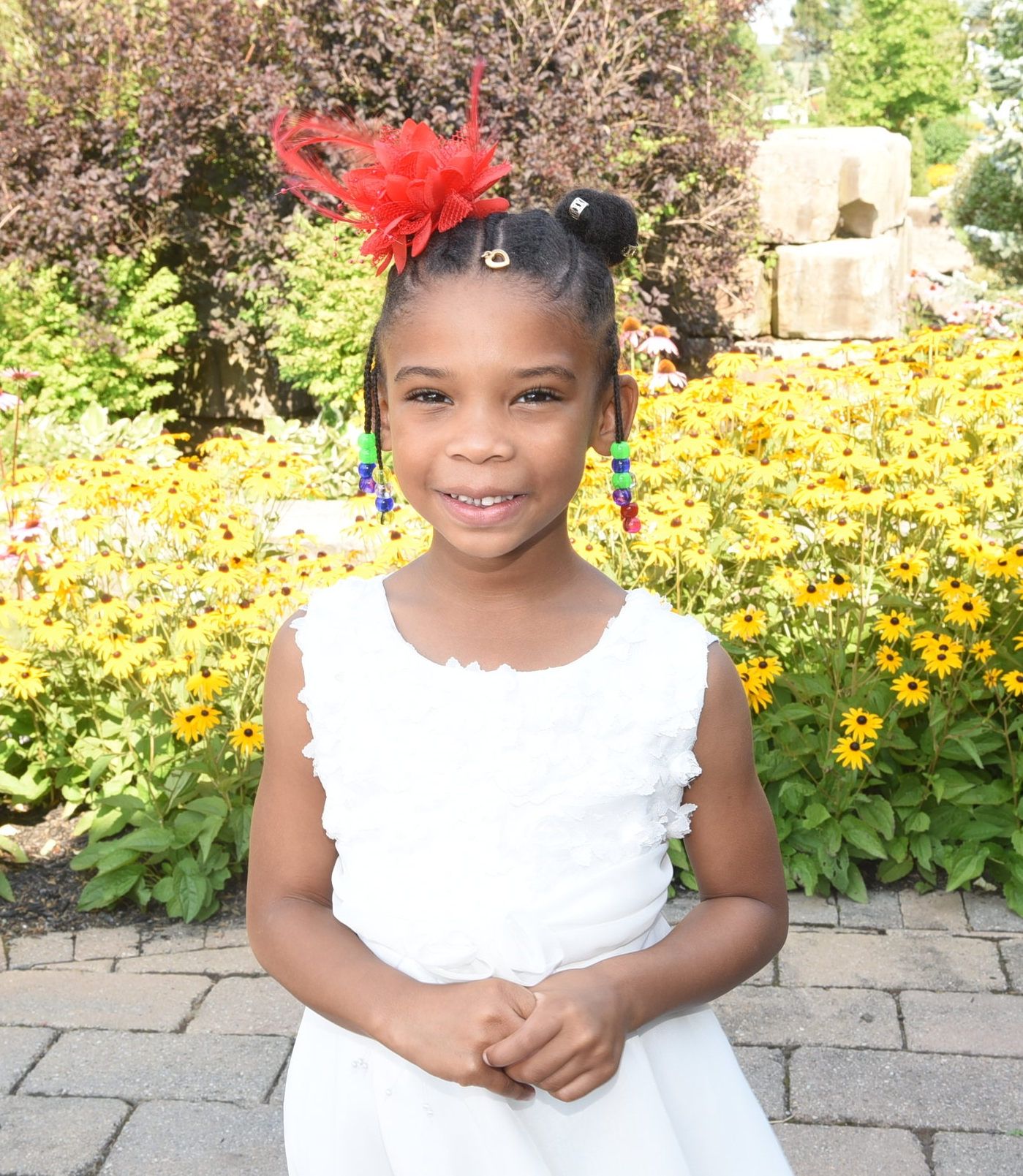Four-year-old Naomi-Grace Goode sang the national anthem at the celebration