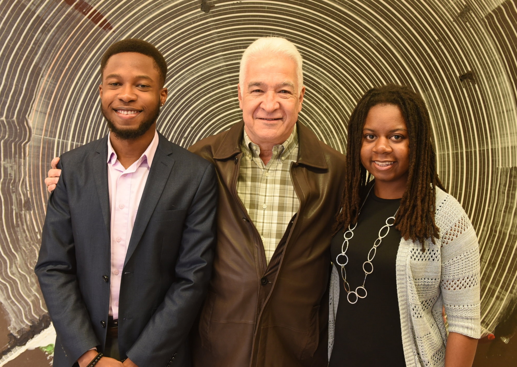 Entrepreneur Efrain Riera presented scholarships to Jaryd Christie and Syenne Holder