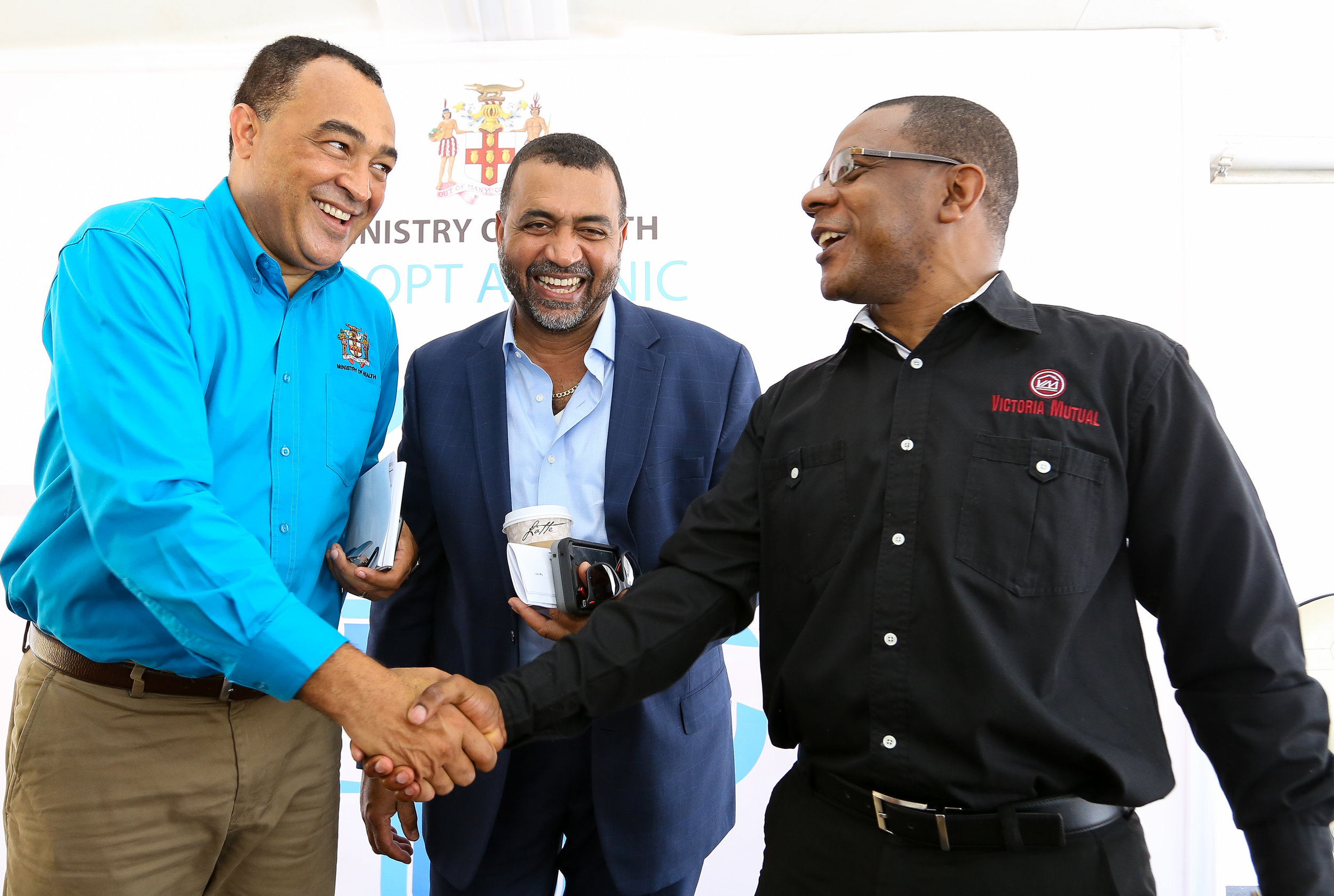 Jamaica's Health Minister Dr. Chris Tufton (l) with chief medical officer Dr. Winston De La Haye & Victoria Mutual Building Society president and CEO Courtney Campbell