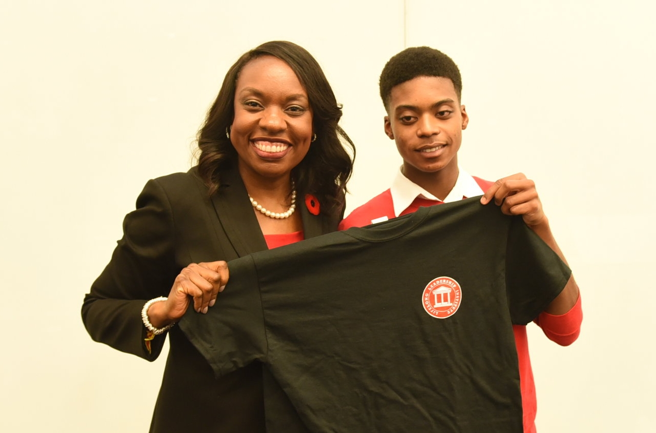 Andre Alexander presented a LBD T-shirt to Education Minister Mitzie Hunter