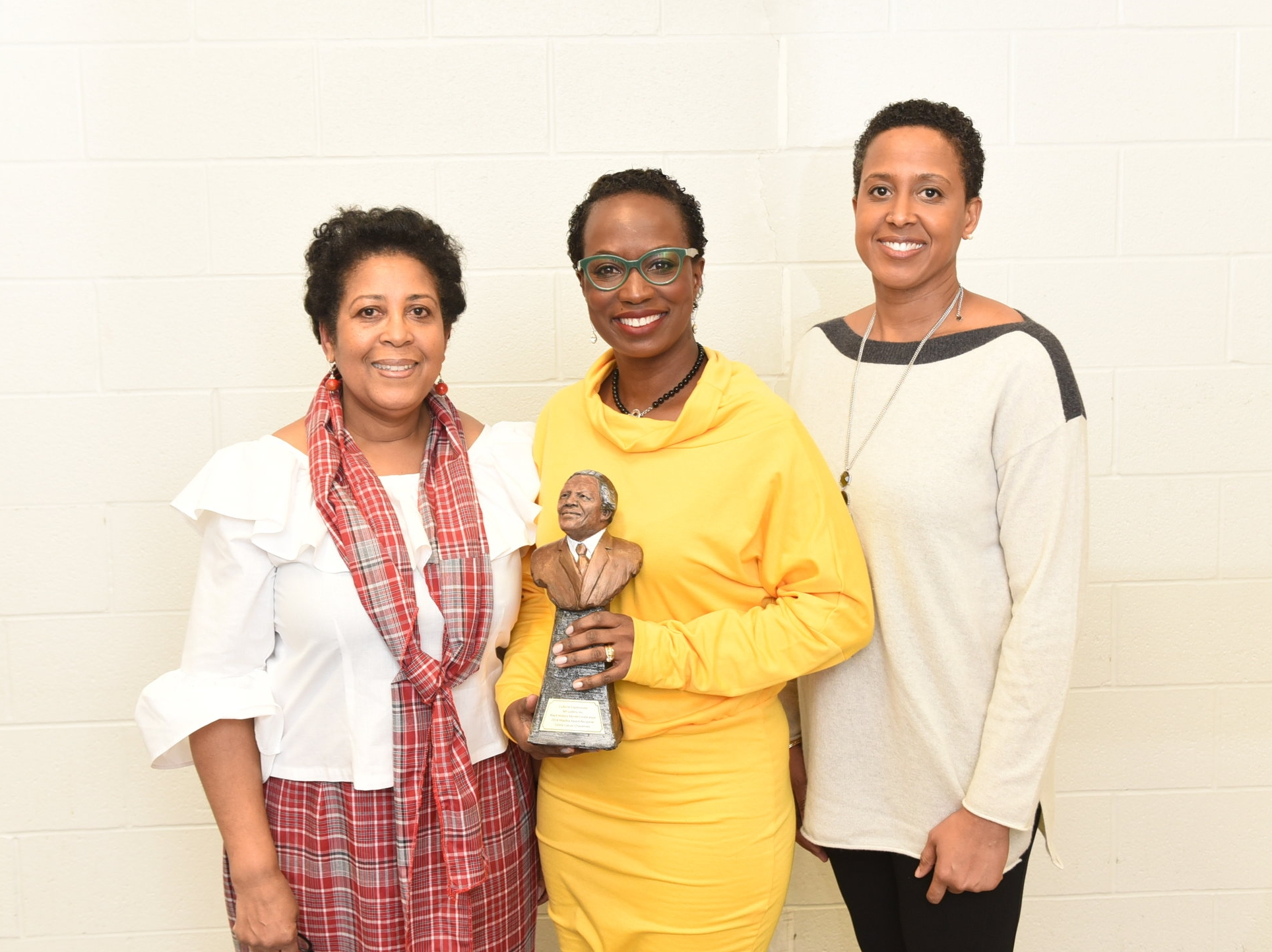 Esther Forde (l) and Durham Black Educators Network chair Eleanor McIntosh presented the Madiba Award to Celina Caesar-Chavannes