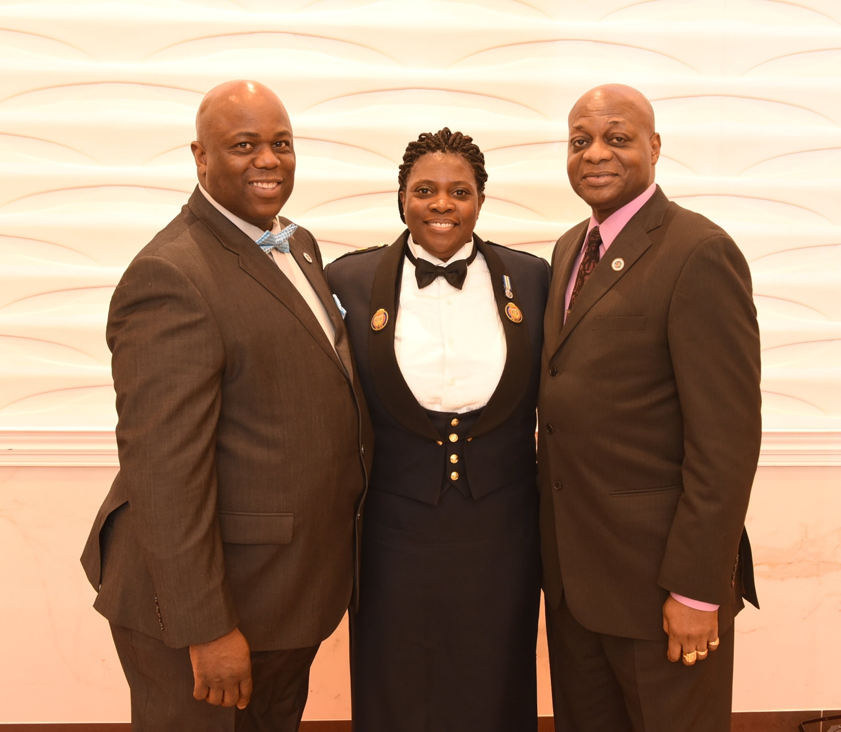 Association of Black Law Enforcers founding president David Mitchell (l) and current president Kenton Chance presented the Lifetime Achievement Award to Inspector Sonia Thomas