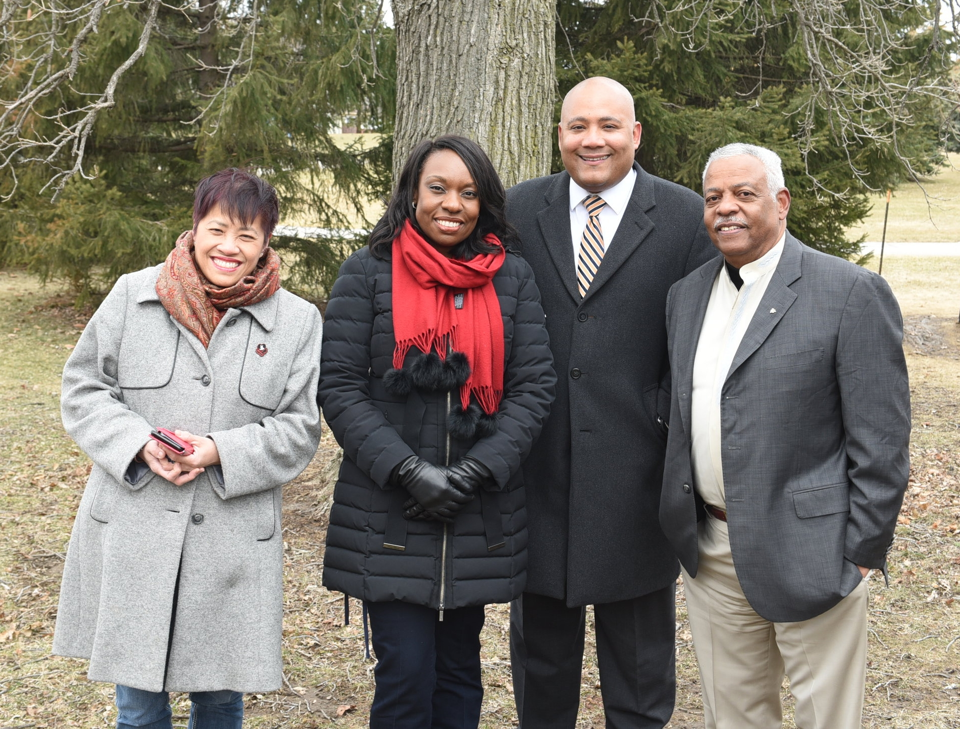 Liberal MPP's Soo Wong, Mitzie Hunter and Michael Coteau with Alvin Curling (r)