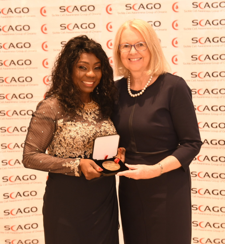 Jane Cordy (r) presented the Senate Medal to Lanre Tunji-Ajayi