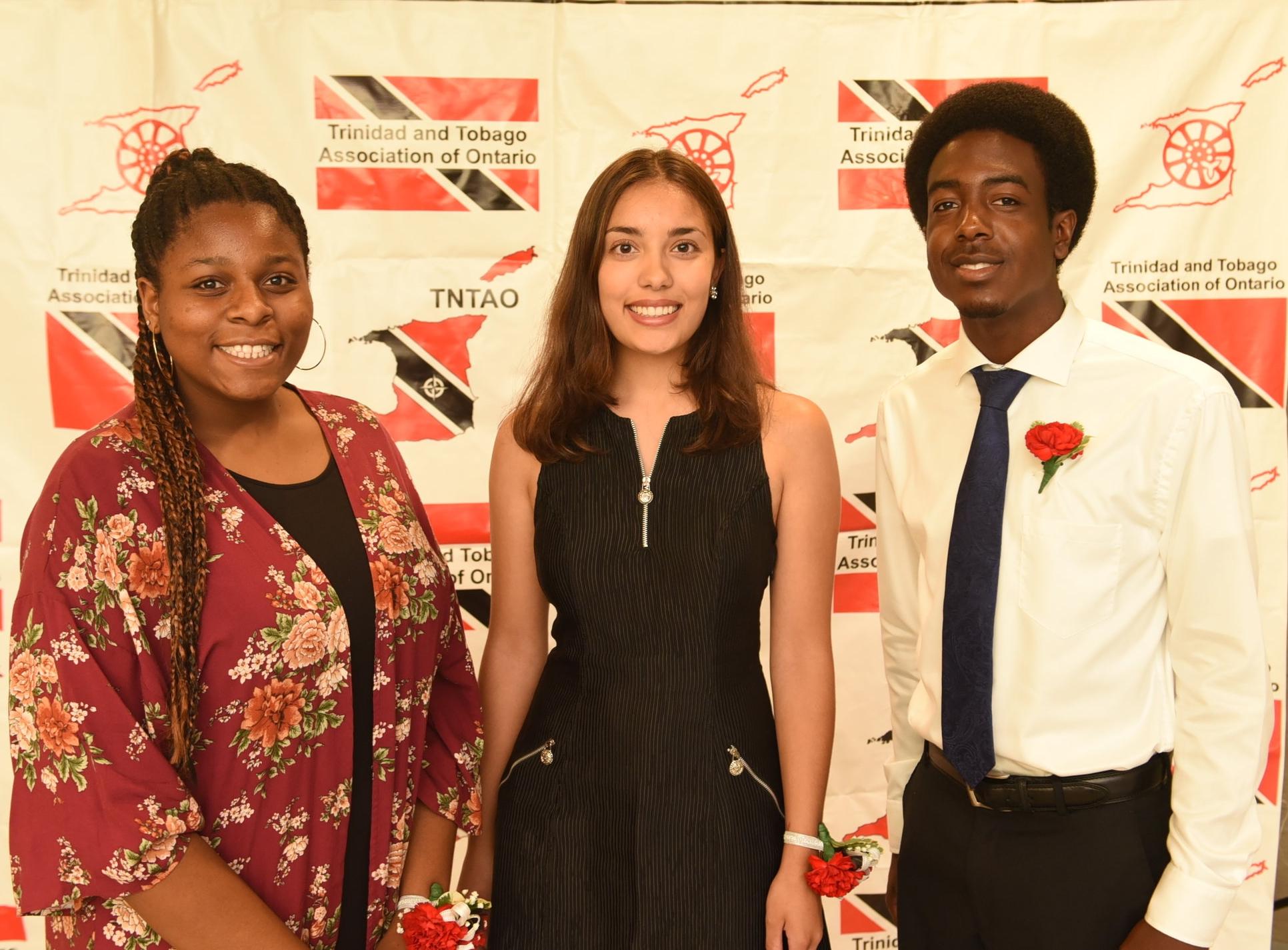 Bursary winners Mikaelia Miller (l), Alice Sandiford & Angelo Grant